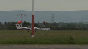 Piper aircraft take off from run way stock footage