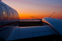 Piper Cheyenne during sunrise. A Piper PA-42 Cheyenne III parked on the apron being prepared for the next flight Royalty Free Stock Images