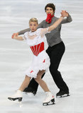 Piper GILLES / Paul POIRIER (CAN). PARIS - NOVEMBER 16: Piper GILLES / Paul POIRIER of Canada perform short dance at the ISU Grand Prix Eric Bompard Trophy on Royalty Free Stock Photo