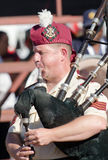 A piper from the SA medical services band. PRETORIA, SOUTH AFRICA -SEPT. 23: A piper from the SAMS band seen during the African Aerospace & Defence show on Sept Royalty Free Stock Photo