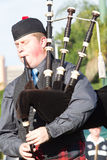 Piper Scottish Highland Gathering Stock Photos