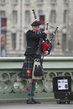 Piper at Westminster Bridge Royalty Free Stock Photo