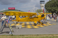 Piper Yellow Cub Airplane. OSHKOSH, WI - JULY 27: A Yellow Piper Cub 75th Anniversary airplane on display at the 2012 AirVenture at EAA on July 27, 2012 in Royalty Free Stock Images