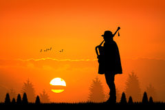 Pipers at sunset Stock Photos