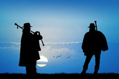 Pipers at sunset Royalty Free Stock Photos