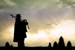 Pipers at sunset Stock Photography