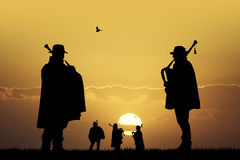 Pipers at sunset Stock Image