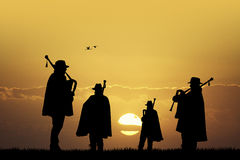 Pipers at sunset Stock Images