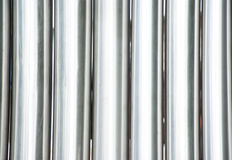 Pipes. Row of the parallel steel pipes Royalty Free Stock Image