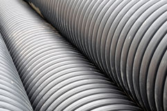 Pipes. Building material pipes on the ground in a constuction site stock photo