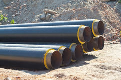 Pipes. Heap of steel tubes covered with foam and plastic Stock Image