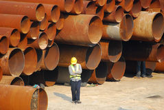 Pipes. Municipal water pipes and a worker with a hard hat royalty free stock photography