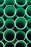 Pipes. Green PVC pipes stacked uniformly.  This type of pipe is typically used to transport water or wastewater (sewage Royalty Free Stock Images