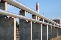 Pipes. Run off into the distance with a smoke stack in background Royalty Free Stock Images
