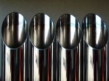 Pipes. Four new chrome muffler pipes Royalty Free Stock Image