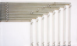 Pipes. White piping on white wall Stock Image