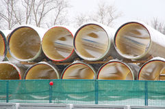 Pipes of big diameter lie under snow Stock Images