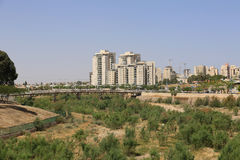 Pipes Bridge and modern buildings in Beer Sheba, Israel. BEER SHEBA, ISRAEL - MAY 2 , 2017: Pipes Bridge and modern buildings in Beer Sheba, Israel Stock Photo