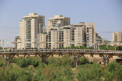 Pipes Bridge and modern buildings in Beer Sheba, Israel. BEER SHEBA, ISRAEL - MAY 2 , 2017: Pipes Bridge and modern buildings in Beer Sheba, Israel Royalty Free Stock Images