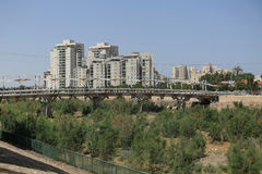 Pipes Bridge and modern buildings in Beer Sheba, Israel. BEER SHEBA, ISRAEL - MAY 2 , 2017: Pipes Bridge and modern buildings in Beer Sheba, Israel royalty free stock photos