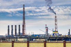 Pipes of a chemical enterprise plant. Air pollution concept. Industrial landscape environmental pollution waste of thermal power stock photos
