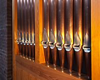 Pipes from a churchorgan. Metallic pipes and wooden framewoork royalty free stock images