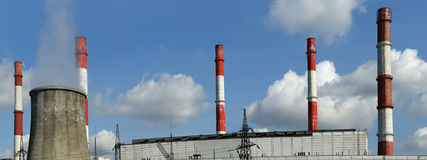 Pipes of coal  burning power station, panorama Royalty Free Stock Images