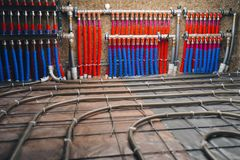 Pipes collector of underfloor heating system. Close-up view stock photography