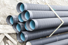 Pipes corrugated industry. A stack of pipes. Royalty Free Stock Images
