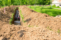 Pipes in a ditch Royalty Free Stock Photo