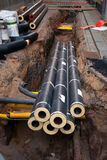 Pipes in dug up street Stock Image