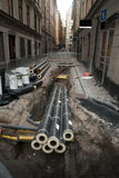 Pipes in dug up street. Dug up street with insulated pipes in a heap royalty free stock image