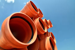 Industrial PVC pipes. Industrial pipes for water transportation against the blue sky in the background stock image