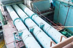 Pipes in the Engine Room for steam turbines stock image
