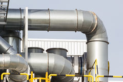 Pipes on exterior of modern factory building. Stock Images