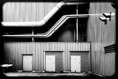Pipes of a factory. Pipes at the back of a factory on a industrial site royalty free stock photos