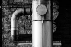 Pipes on a factory wall royalty free stock photography