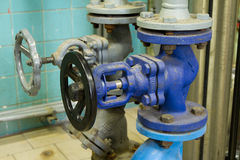 Pipes and faucet valves of heating system Royalty Free Stock Image