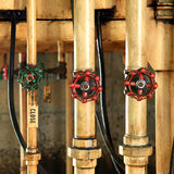 Pipes and faucet valves of oil system Stock Photo