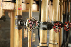 Pipes and faucet valves of oil system Royalty Free Stock Images