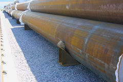 Pipes are on the finished-products storage area. Big diameter ferrous metal pipes are on the storage yard Royalty Free Stock Photography