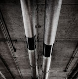 Pipes on the garage ceiling in grunge style. Pipes on the ceiling of a garage,  processed in grunge style Royalty Free Stock Photo