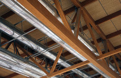 Pipes of a heating and air-conditioning under the roof Stock Images