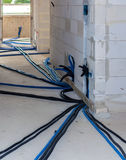 Pipes and heating system at house construction site. Floor heating system, the collector and tools stock photos
