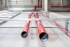 Pipes of a huge sprinkler system. Connection point of an emergency indoor sprinkler system Stock Photos