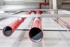 Pipes of a huge sprinkler system. Connection point of an emergency indoor sprinkler system Stock Images