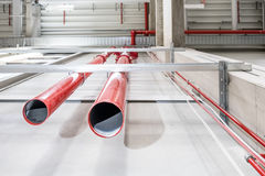 Pipes of a huge sprinkler system. Connection point of an emergency indoor sprinkler system Stock Photography