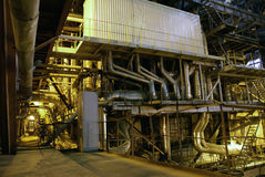 Pipes inside energy plant. Inside of a power plant with pipes and boiler Stock Photos
