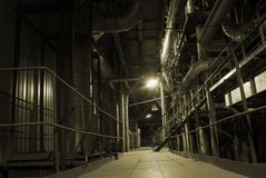 Pipes inside energy plant. An assortment of different size and shaped pipes at a power plant Stock Photography