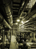 Pipes inside energy plant. Different types of pipes and tanks inside energy plant Royalty Free Stock Photo